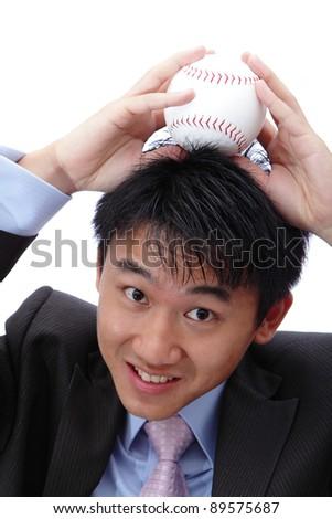 Business man put baseball on his head - stock photo