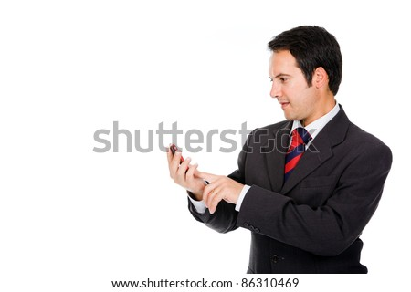 Business man reading a interesting message on his cell phone, isolated on white - stock photo