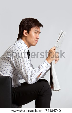 Business man reading newspaper - stock photo