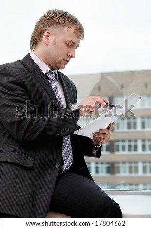 business man reading the document - stock photo