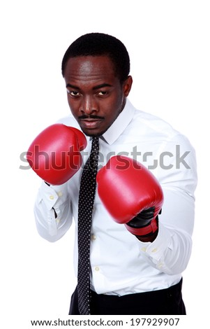 Business man ready to fight with boxing gloves isolated over white background - stock photo