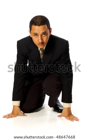 Business man ready to run isolated on white background - stock photo