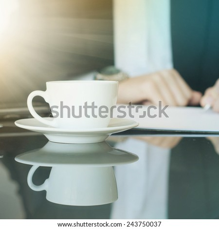 Business man relaxing after working and drinking coffee - stock photo
