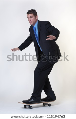 business man riding a  skateboards - stock photo