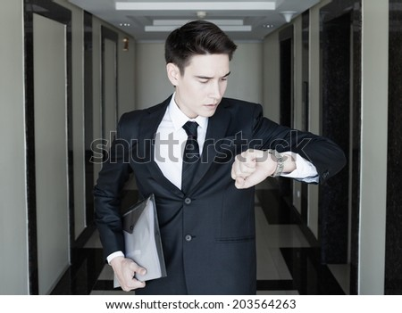 Business man running late for work. - stock photo