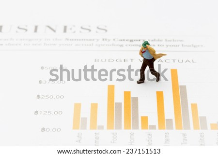 Business man running top of graph - stock photo