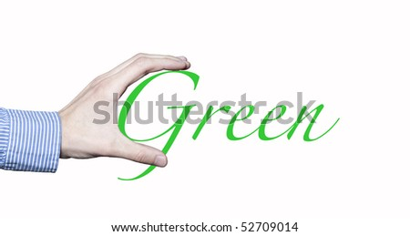 Business man's hand holding the word green. - stock photo