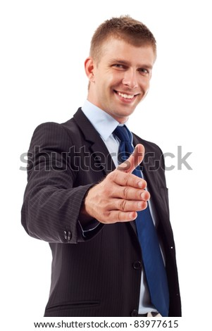 Business man saying welcome by giving the hand for shake, focus on hand - stock photo