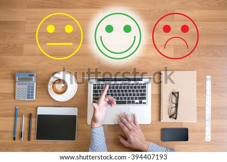 business man select happy on satisfaction evaluation? and hands at work with financial reports and a laptop with other objects around, coffee,  top view,free copyspace - stock photo