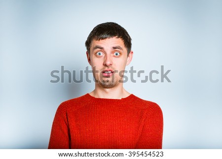 business man shocked isolated on a gray background. Positive human emotion facial expression - stock photo