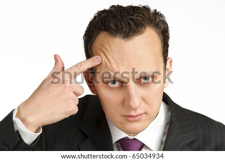 Business man shooting himself with forefinger, studio shot isolated on white background - stock photo