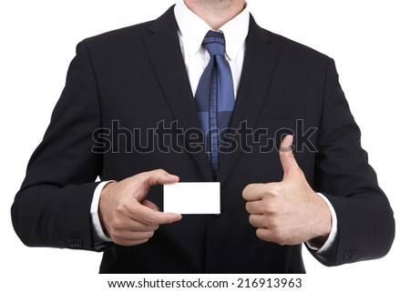 Business man showing a blank card gesturing thumbs up isolated on a white background - stock photo