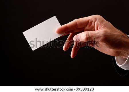 business man showing blank business card - stock photo