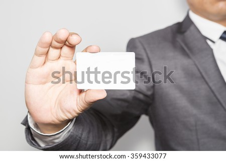 business man showing business card , business idea concept - stock photo