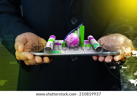 Business man showing growth graph and  globe - stock photo