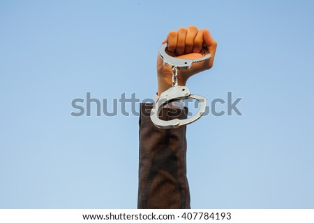 Business man showing handcuffs after releasing it. Financial freedom or business criminal concept. - stock photo