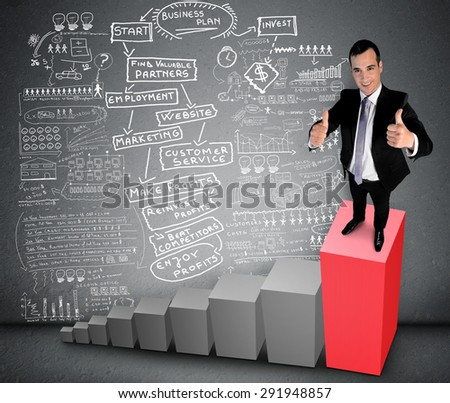 Business man showing ok sign on top of chart - stock photo