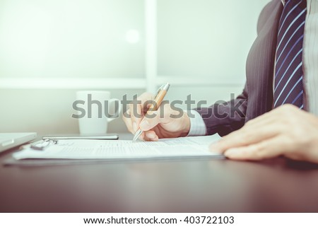 Business man signing a contrac. Lawyers are signing on paper. Businessmen are signed resignation.  - stock photo