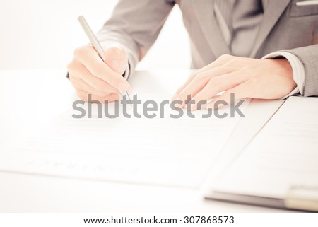 Business man signing a contract - stock photo