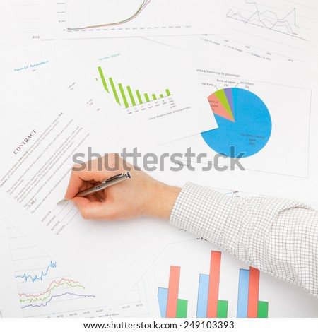 Business man signing contract - studio shot - stock photo