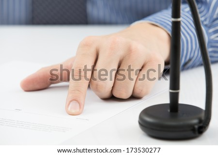 Business man signing finance contract - stock photo