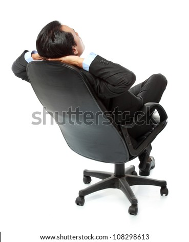 business man sitting and relaxing on chair isolated on white background - stock photo