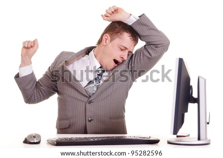 business man sitting at a laptop on a background - stock photo