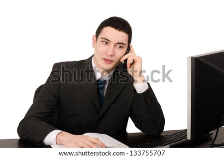Business man sitting at desk talking on the phone. Happy business man hearing good news on the phone. Isolated on white. - stock photo