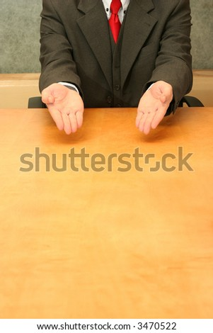 Business-man sitting at the desk, complaining about something. - stock photo