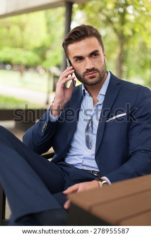 Business man sitting in a cafe - stock photo