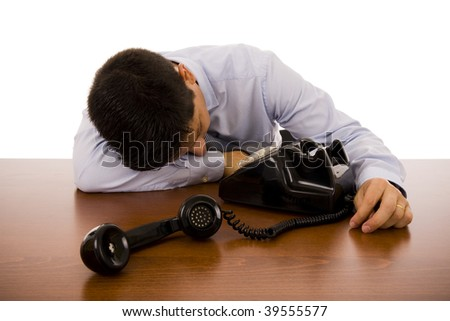 Business man sleeping on his desk - stock photo