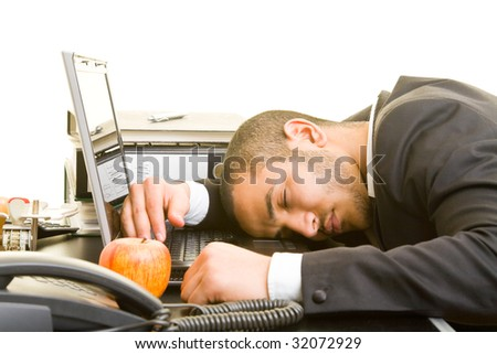 Business man sleeping on his laptop at his desk - stock photo