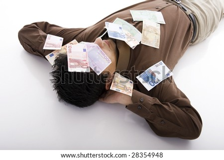 Business man sleeping with many euro banknotes - stock photo