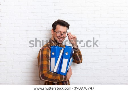Business Man Smile Busy Wear Glasses Holding Many Folders Lot of Work Overload Office Over White Brick Wall - stock photo