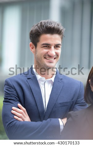 Business man smile with business office building background, caucasian, shot in Hong Kong - stock photo