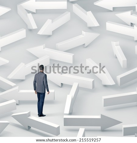 Business man standing among lots of white arrows - stock photo