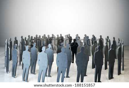 business man standing among people silhouettes - stock photo
