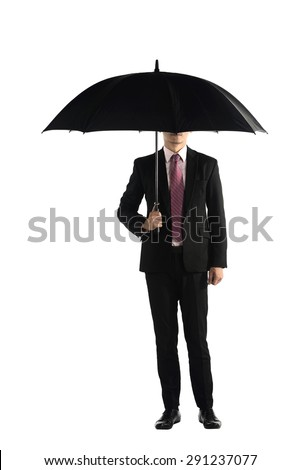 Business man standing holding umbrella isolated over white background - stock photo
