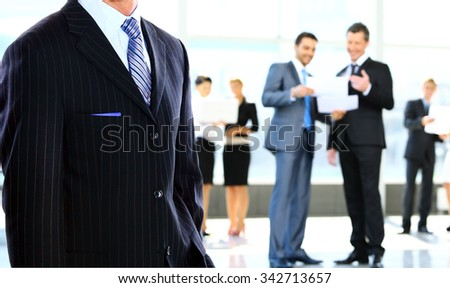 business man standing in an office - stock photo