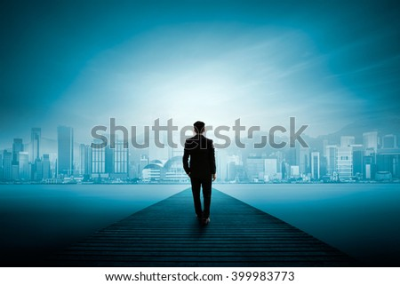 Business man standing on wooden bridge and looks at the city, Business success concept - stock photo