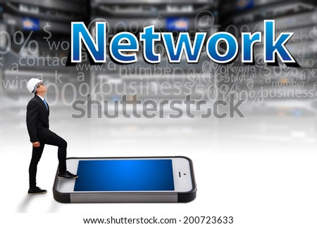 Business man step on smart phone and looking at network - stock photo