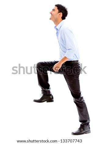 Business man stepping up for success - isolated over a white background - stock photo