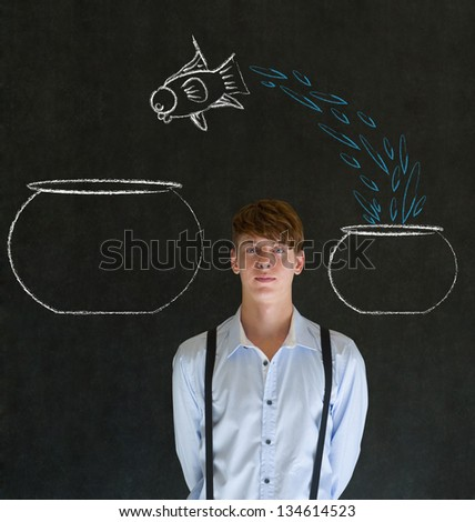 Business man, student or teacher with fish jumping from small bowl to big bowl on blackboard background - stock photo