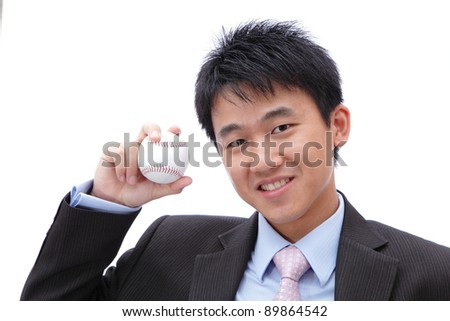 Business Man Take baseball in the hand with smile - stock photo