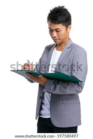 Business man take note on clipboard - stock photo
