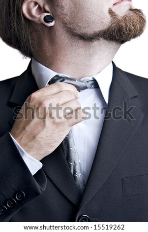 business man taking his uncomfortable tie off - stock photo