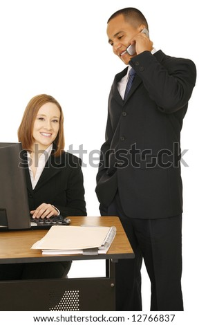 business man talking on the phone while business woman sitting down looking at camera and smile. concept for business communication, office related - stock photo