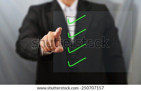 business man touch check box list - stock photo