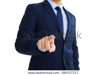 Business man touch screen against white background - stock photo
