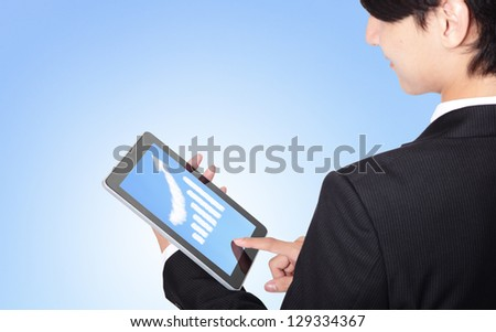 business man touch tablet pc, with a growth graph ( made by cloud ) in the air with blue sky, finance and business concept, asian model - stock photo